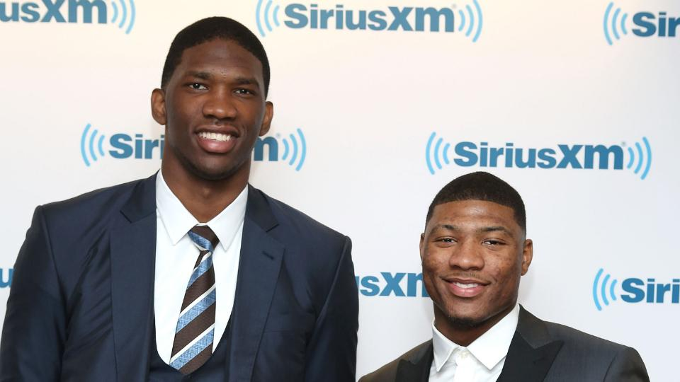 Joel Embiid (left) and Marcus Smart (right) have signed deals with adidas.