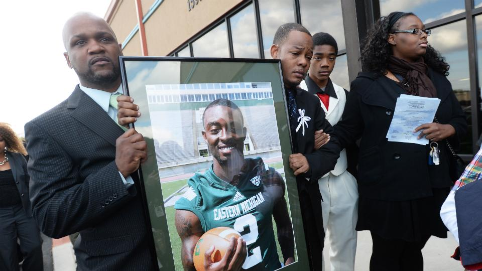 Family members mourned Eastern Michigan's Demarius Reed at his funeral in October.