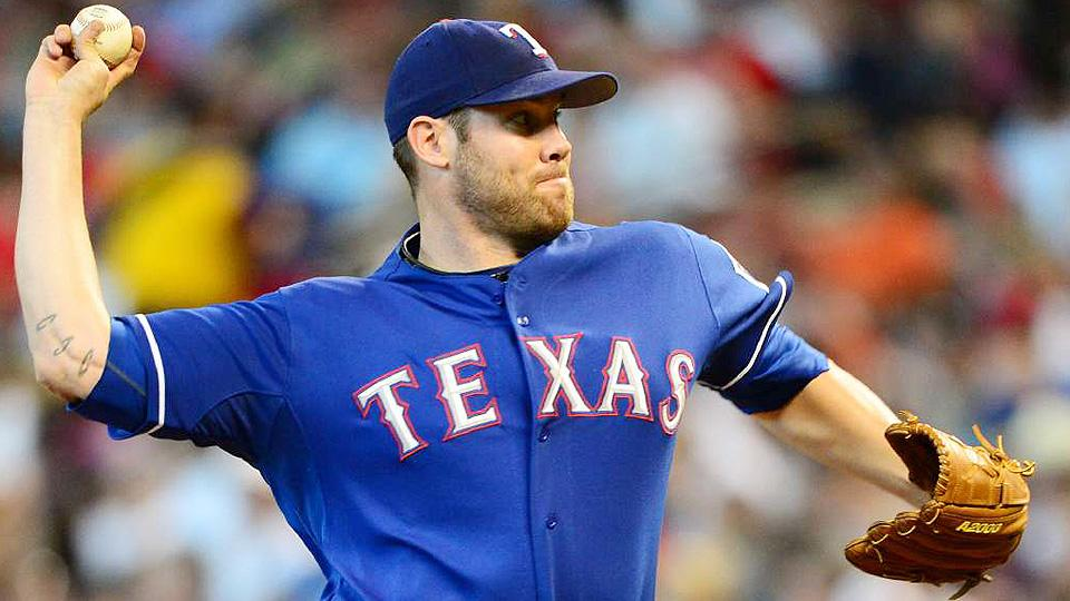 Rangers pitcher Colby Lewis takes offense to Colby Rasmus' bunt