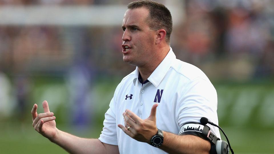 Northwestern coach Pat Fitzgerald won his own autographed football