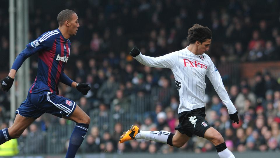 Fulham's Costa Rican striker Bryan Ruiz shoots as Stoke City's French midfielder Steven N'Zonzi closes in during the English Premier League football match between Fulham and Stoke City at Craven Cottage in London on February 23, 2013.