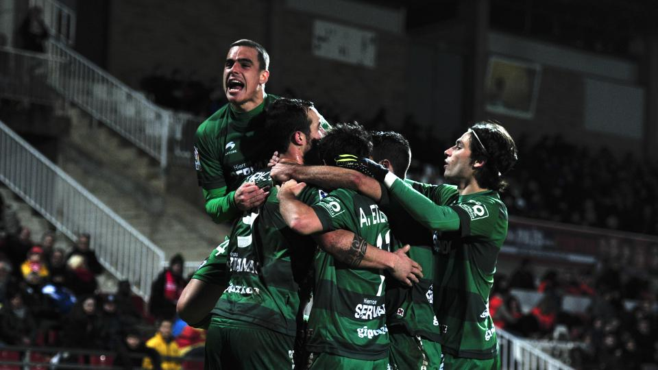 Urko Vera of SD Eibar is congratulated by his teammates during the Spanish Segunda Division match between Girona FC and SD Eibar at the Estadia Montilivi on January 25, 2014.