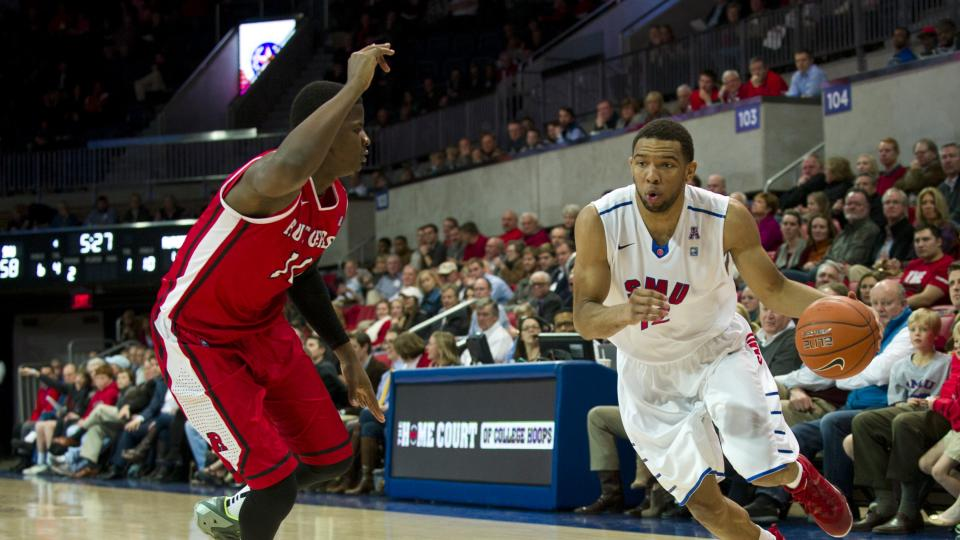 Nick Russell of the SMU Mustangs drives to the basket against the Rutgers Scarlet Knights on January 21, 2014 at Moody Coliseum in Dallas, Texas.