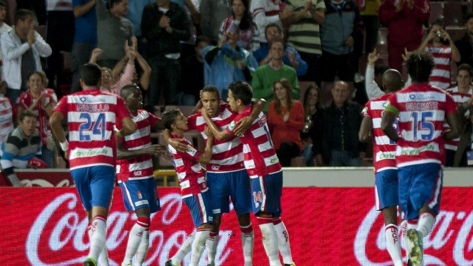 Granada's Moroccan forward Youssef El-Arabi (C) celebrates with his teammates after scoring in Granada on September 30, 2013.