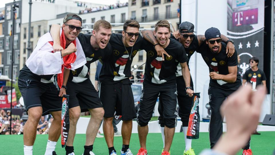 Members of the German national team celebrate the country's 2014 FIFA World Cup victory.