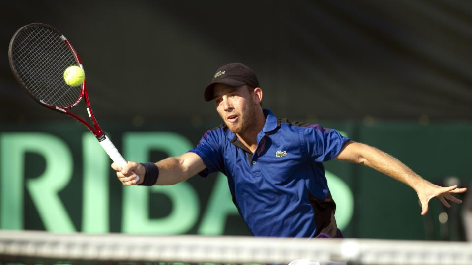 Israeli tennis player Dudi Sela returns to Canada's Milos Raonic during their Davis Cup match on September 18, 2011 in Ramat Hasharon, north of Tel Aviv.