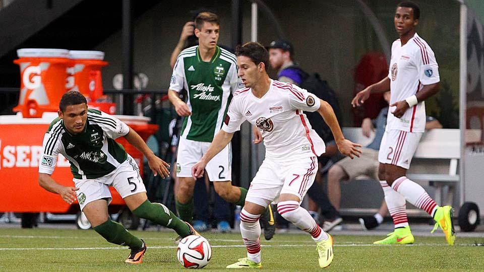 MLS Homegrown player Zach Pfeffer (7) tries to fend off Portland U-23 midfielder Christian Roldan.