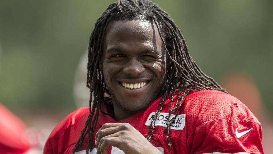 Kansas City Chiefs running back Jamaal Charles smiles at the end of practice during Kansas City Chiefs summer training camp practice.