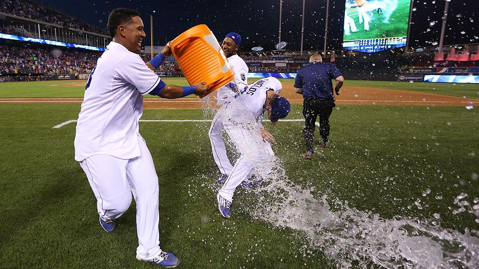 Salvador Perez (left) and Jarrod Dyson doused James Shields after his four-hit shutout that kept the Royals in contention for an AL Central crown.