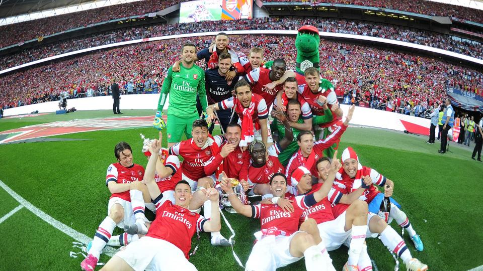 The Arsenal squad celebrate after the FA Cup Final between Arsenal and Hull City at Wembley Stadium on May 17, 2014 in London, England.