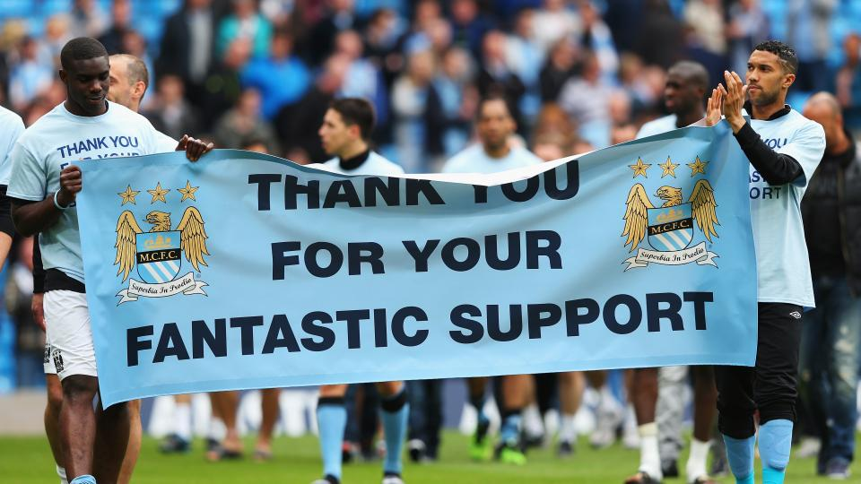 Micah Richards, Gael Clichy and the rest of the Manchester City players thank their fans for their support following the Barclays Premier League match between Manchester City and Norwich City at Etihad Stadium on May 19, 2013 in Manchester, England.
