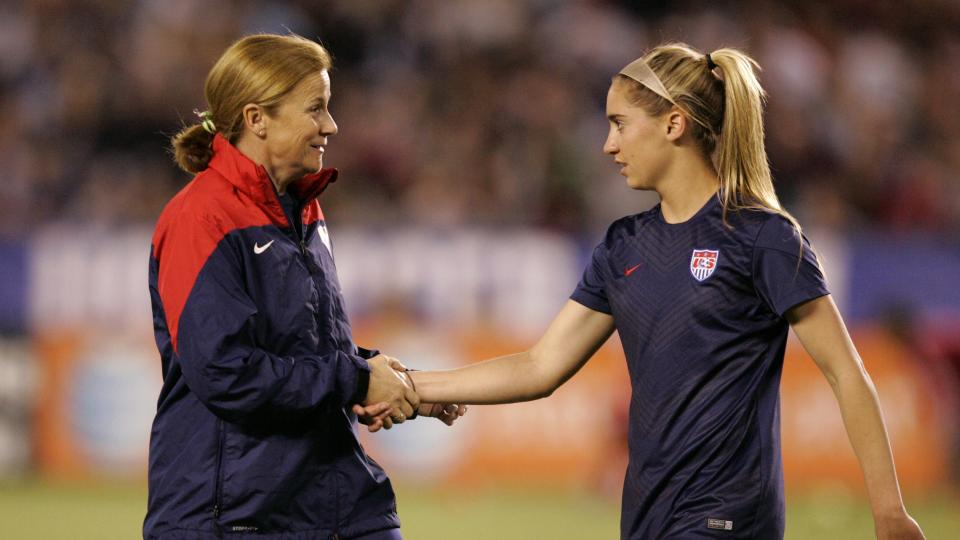 Interim head coach Jill Ellis of the United States shakes hands with Morgan Brian #7 prior to the first half of the game against China during an international firendly match at Qualcomm Stadium on April 10, 2014 in San Diego, California.