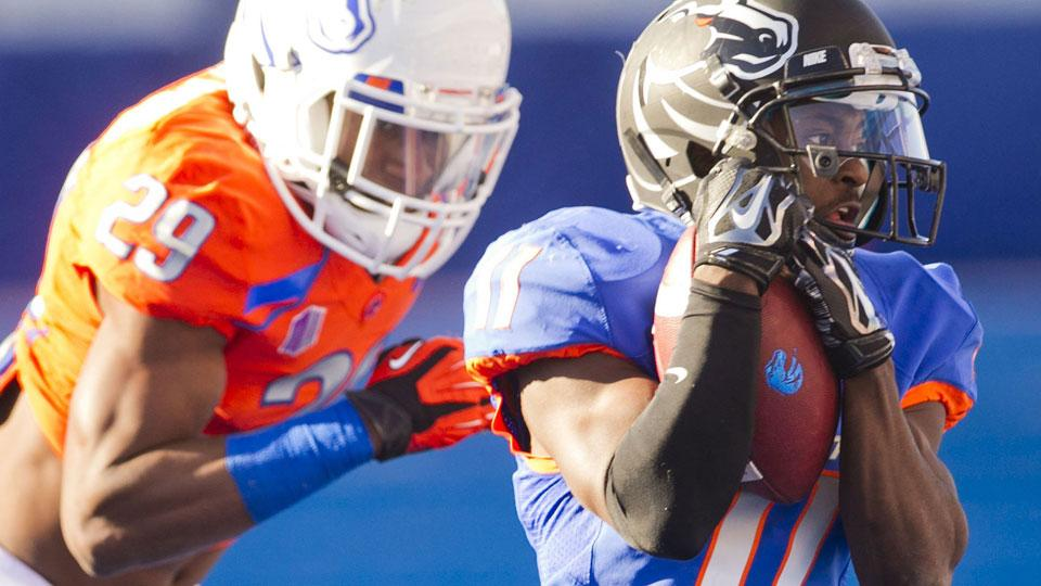 Boise State football unveils new orange helmets