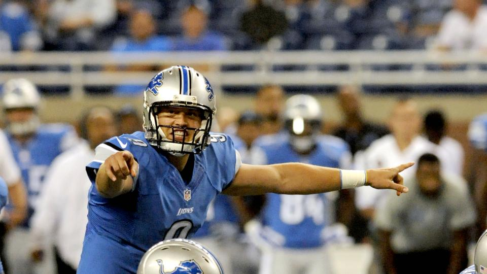Quarterback Matthew Stafford of the Detroit Lions yells out an audible at the line of scrimmage during a preseason game against the Cleveland Browns on August 9, 2014 at Ford Field in Detroit, Michigan. Detroit won 13-12.