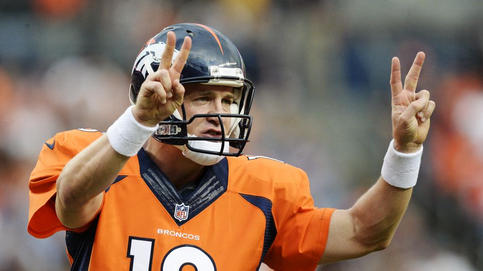 Denver Broncos quarterback Peyton Manning signals out during the first quarter against the Seattle Seahawks August 7, 2014 at Sports Authority Field at Mile High Stadium.