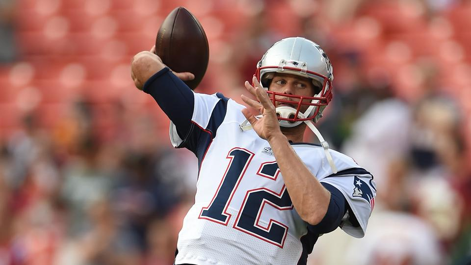 Quarterback Tom Brady of the New England Patriots warms up before playing the Washington Redskins during a preseason NFL game at FedExField on August 7, 2014 in Landover, Maryland. The Washington Redskins won, 23-6.
