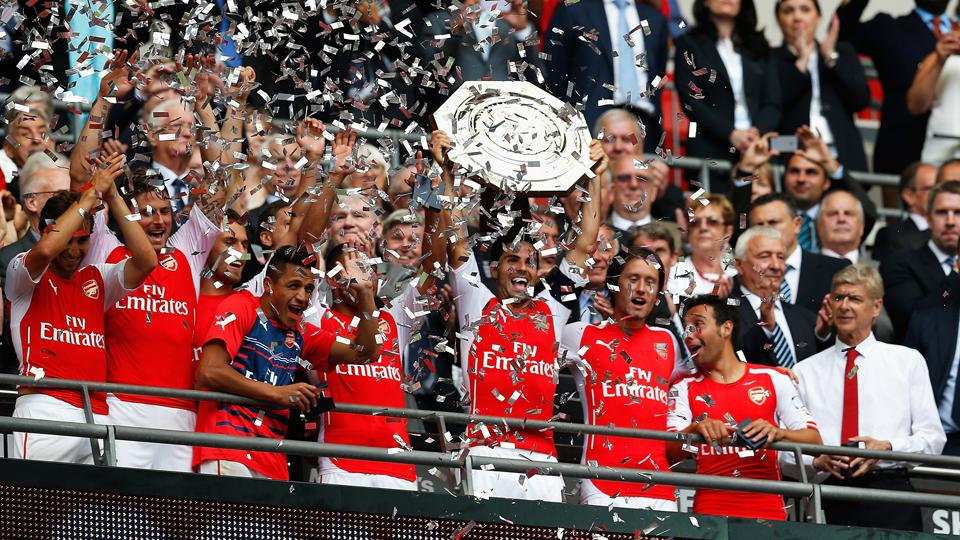 Arsenal's Mikel Arteta lifts the Community Shield, what the Gunners hope is the first of multiple trophies in the 2014-15 season.