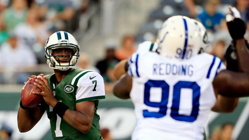 Quarterback Geno Smith of the New York Jets passes against the Indianapolis Colts in the first quarter during a preseason game at MetLife Stadium on August 7, 2014 in East Rutherford, New Jersey.