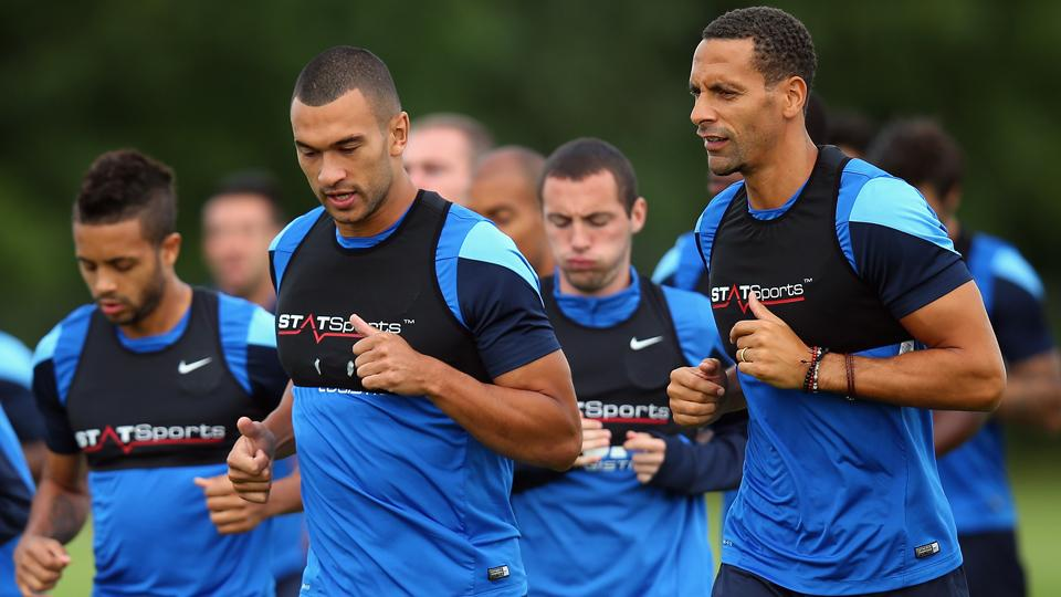 Former Manchester United stalwart Rio Ferdinand, right, starts a new chapter of his career with Queens Park Rangers.