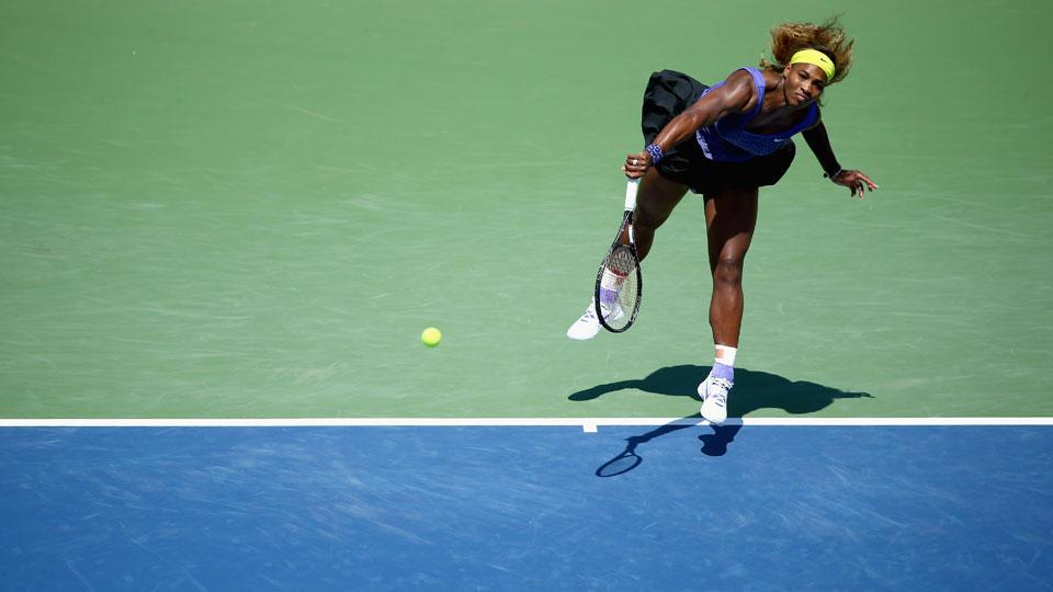 Serena Williams serves at the Western & Southern Open tennis tournament, Friday, Aug. 15, 2014, in Mason, Ohio.