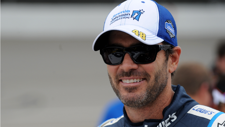 Driver Jimmie Johnson tries to shift with pliers