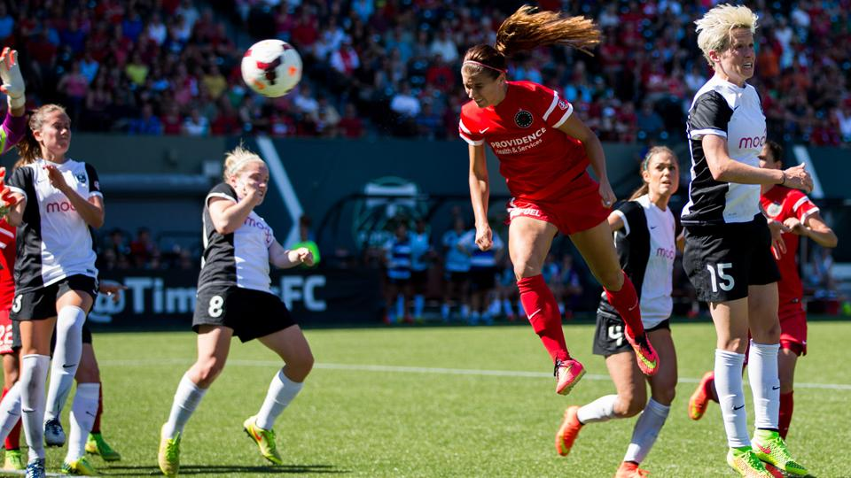 USWNT star Alex Morgan, above scoring on a vital header Sunday for the Portland Thorns, is one of a number of women's stars fed up with FIFA over the turf field at venues for next year's World Cup.
