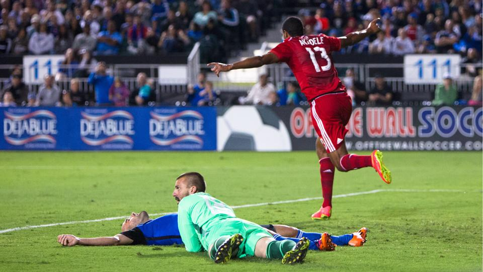FC Dallas rookie Tesho Akindele leaves San Jose Earthquakes defender Brandon Barklage and goalkeeper Jon Busch in his wake after scoring one of his three goals Saturday night.