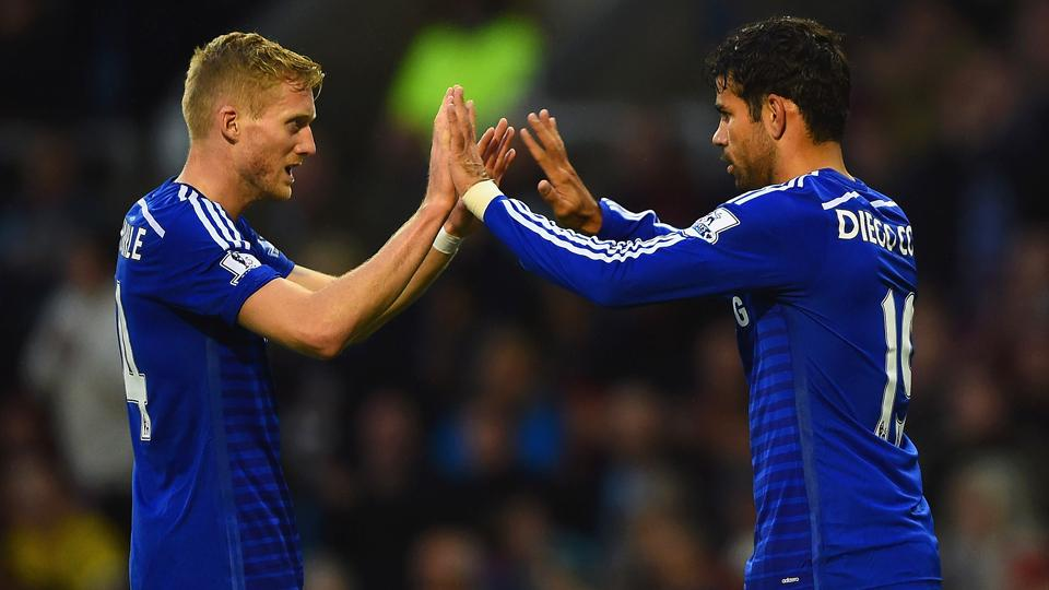 Diego Costa, right, looked right at home for Chelsea in his Premier League debut, scoring in a 3-1 victory over Burnley.