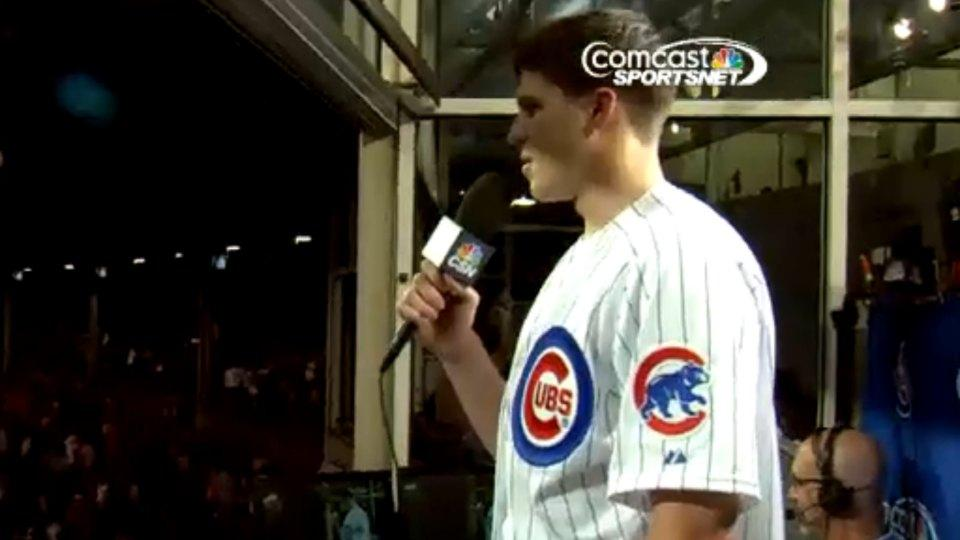 Bulls' Doug McDermott tries to sing during Cubs' 7th inning stretch, fails