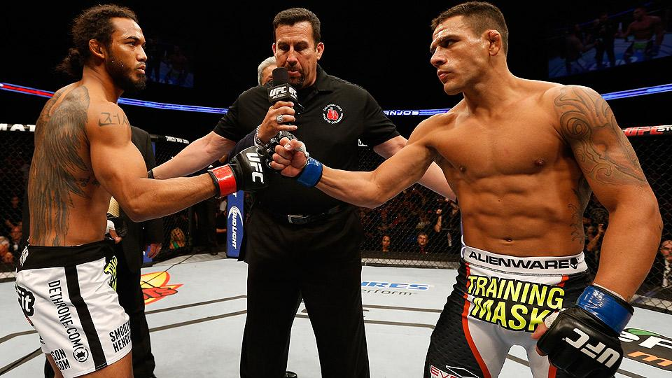 Rafael dos Anjos (right) made quick work of Benson Henderson (left), a 5-1 favorite, with a first-round knockout for a major UFC Fight Night 49 upset in Tulsa, Okla.