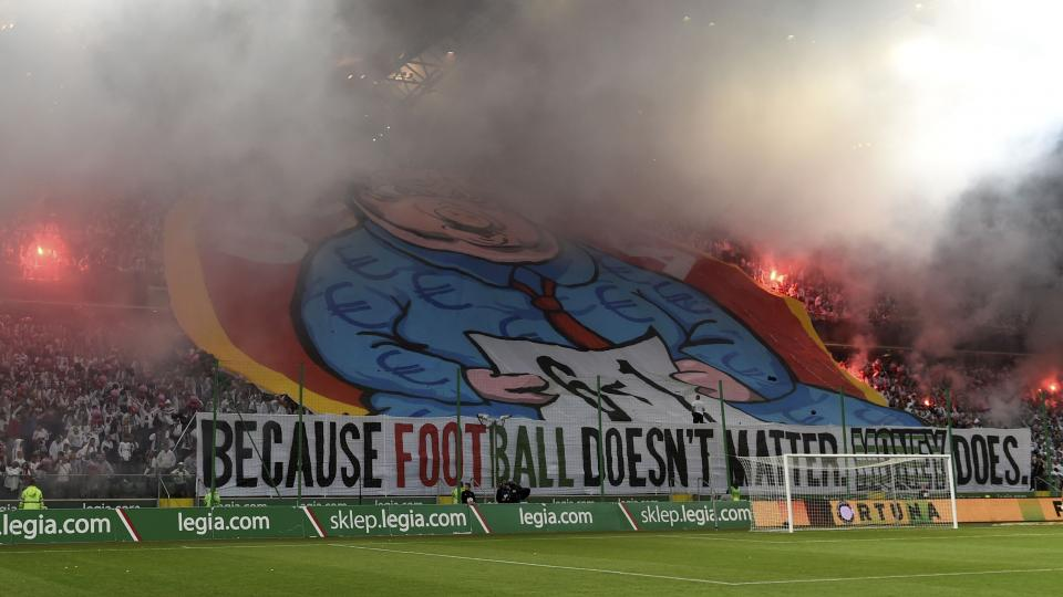 UEFA charges Legia Warsaw for fans' Champions League protest banner