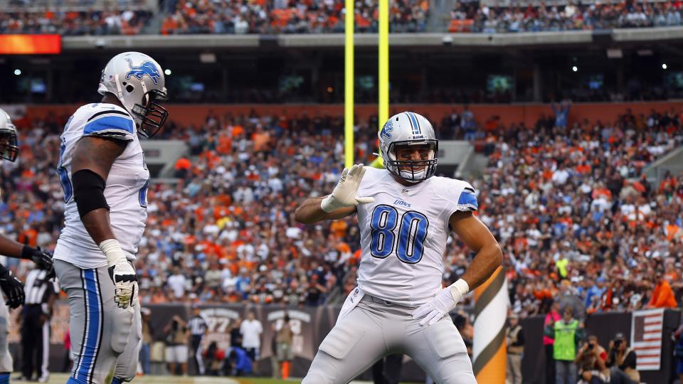 Tight end Joseph Fauria (#80) of the Detroit Lions celebrates with tackle Corey Hilliard (#78) after scoring a touchdown against the Cleveland Browns at FirstEnergy Stadium on October 13, 2013.