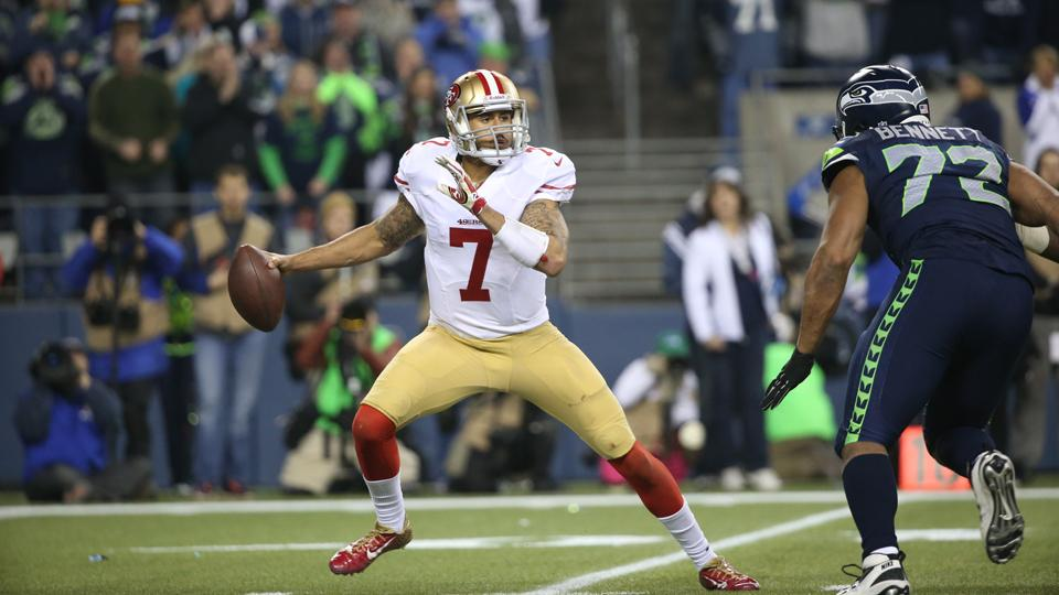 San Francisco 49ers quarterback Colin Kaepernick scrambles to pass the ball the ball during the NFC Championship playoff game between the San Francisco 49ers against the Seattle Seahawks on Sunday, Jan. 19, 2014 in Seattle, WA.