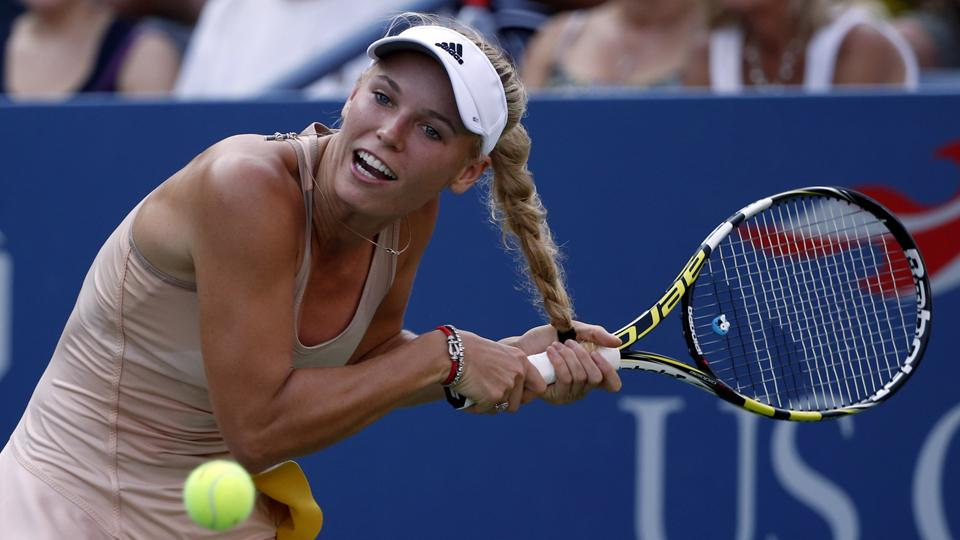Bad hair play: Wozniacki's hair gets caught in her racket during a point