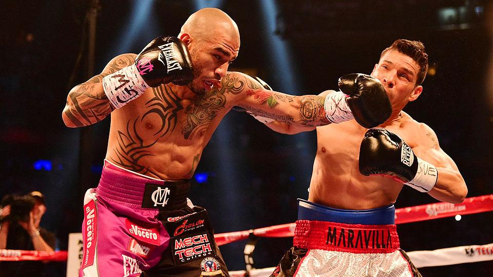 Miguel Cotto (left) dominated his matchup with Sergio Martinez at Madison Square Garden, but a limited pay-per-view audience actually watched.