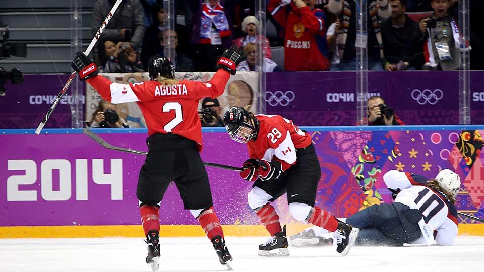 Canada's Marie-Philip Poulin (right) drove home the dagger in OT after Team USA squandered a 2-0 lead and was deprived of gold by a goalpost.