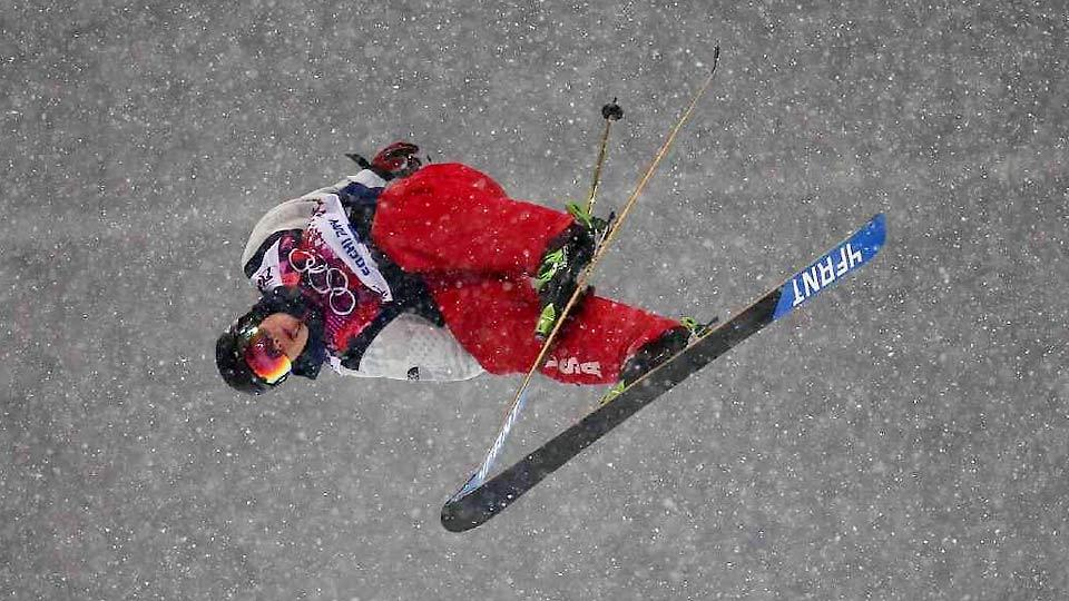 Despite heavy snow that reduced skiers' speed in the halfpipe, David Wise managed to throw two double-cork 1260s in his gold-medal-winning run Tuesday.