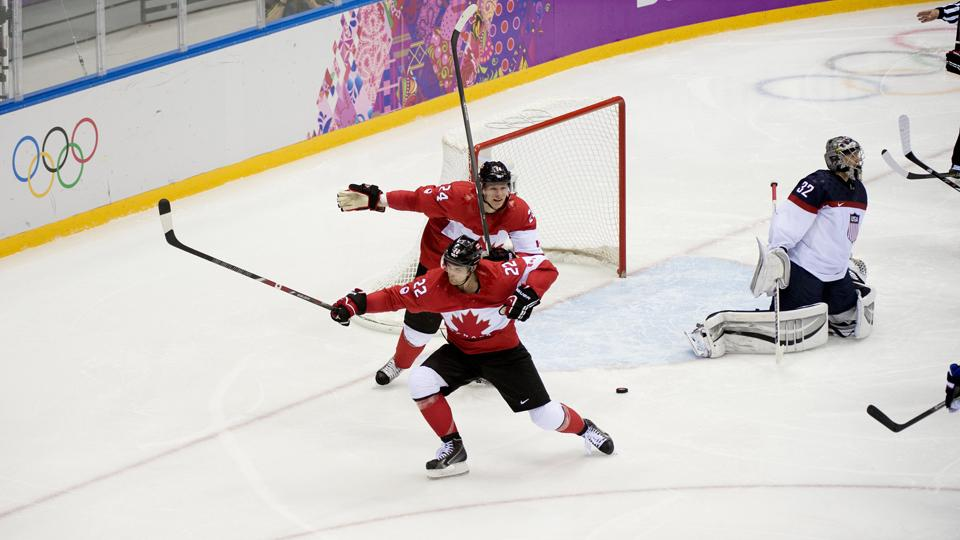 Jamie Benn (22) and Corey Perry celebrate Benn's second-period goal that gave Canada a 1-0 semifinal victory over the U.S.