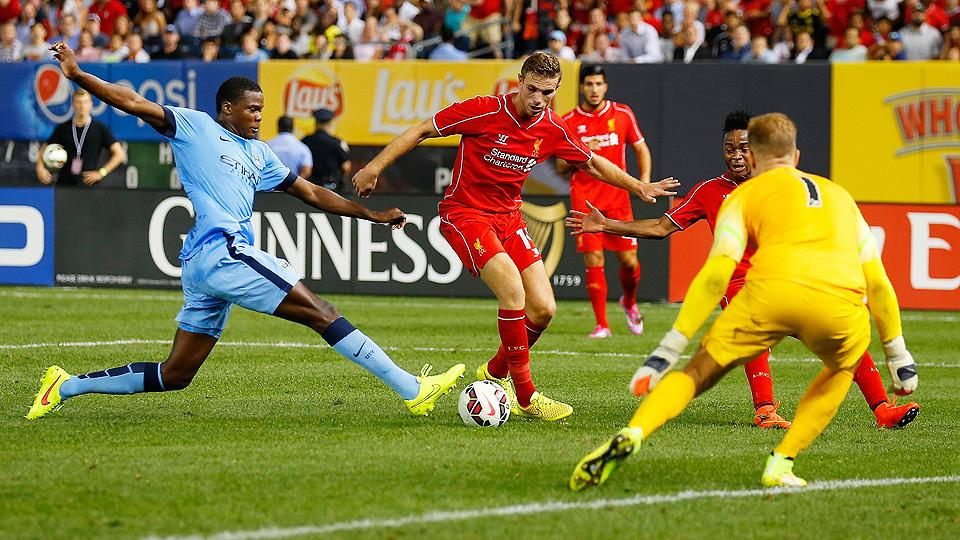 Jordan Henderson (with ball) and Liverpool topped Joe Hart and Manchester City on penalties.