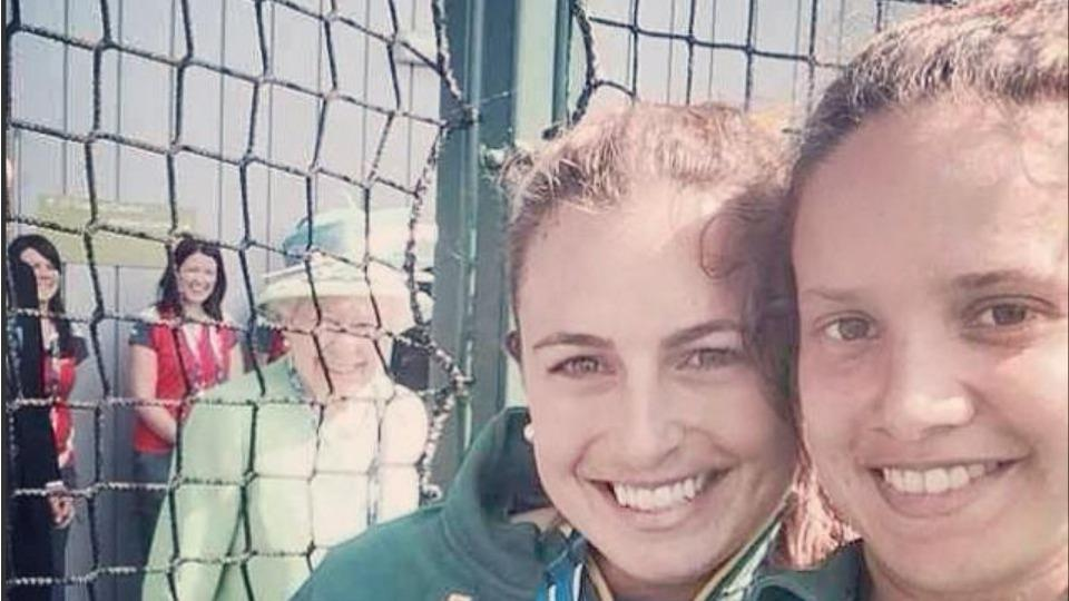 The Queen of England photobombed some field hockey players at the Commonwealth Games