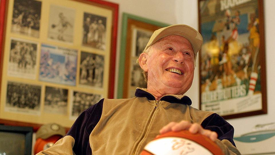Red Klotz, owner of full-time Globetrotters' opponent the New York Nationals, smiles inside his office at his home in Margate, N.J. Klotz is the losingest coach in basketball history, but considers himself lucky to have traveled the world playing basketball.