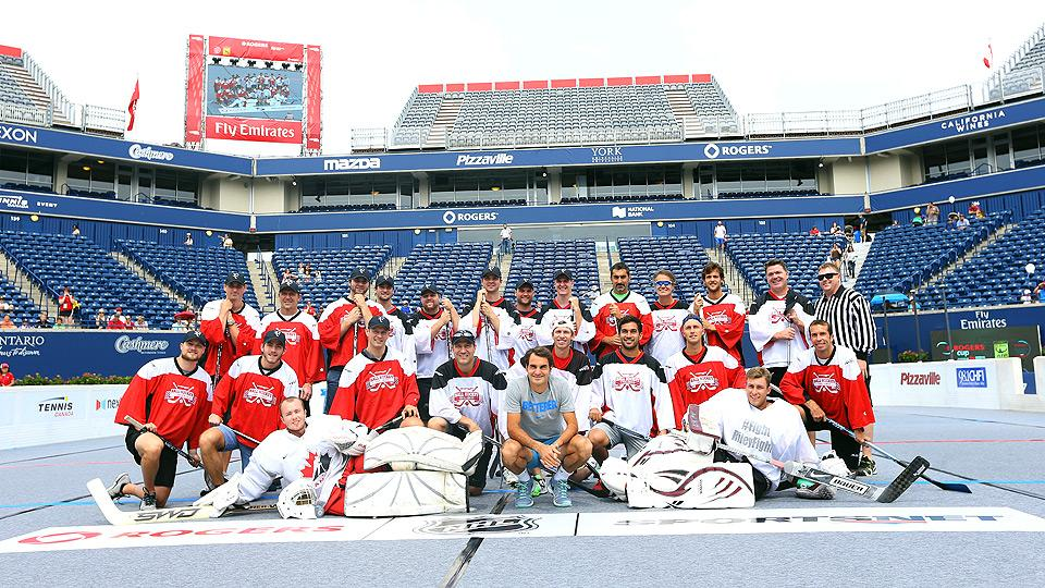 Photos: Federer plays hockey versus team of NHL stars