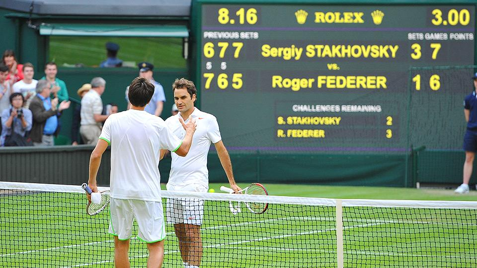 Sergiy Stakhovsky (left) shocked Roger Federer in the second round of Wimbledon in 2013.