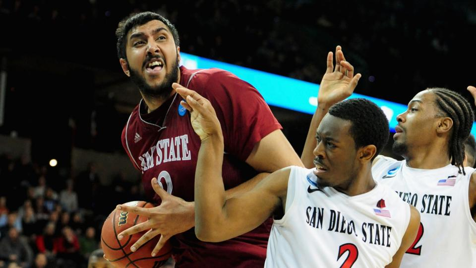 Sacramento signed 7-foot-5 Indian Sim Bhullar after he wasn't selected during the NBA draft.