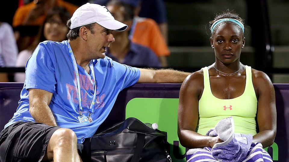 Paul Annacone talks with Sloane Stephens during her match against Caroline Wozniacki at the Sony Open.