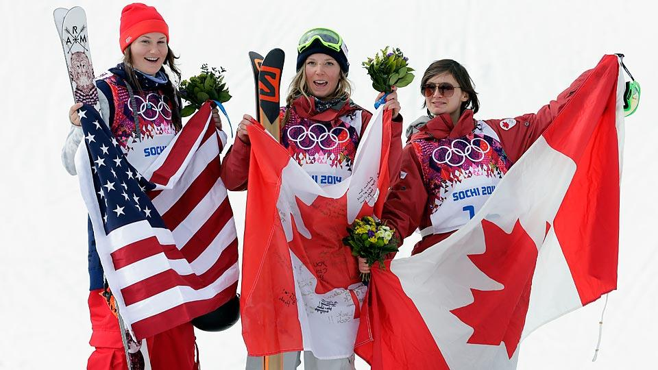 The U.S.' Devin Logan (left) knew what judges want to see, but Canada's Dara Howell (center) had a near-perfect run to capture gold in women's slopestyle skiing.