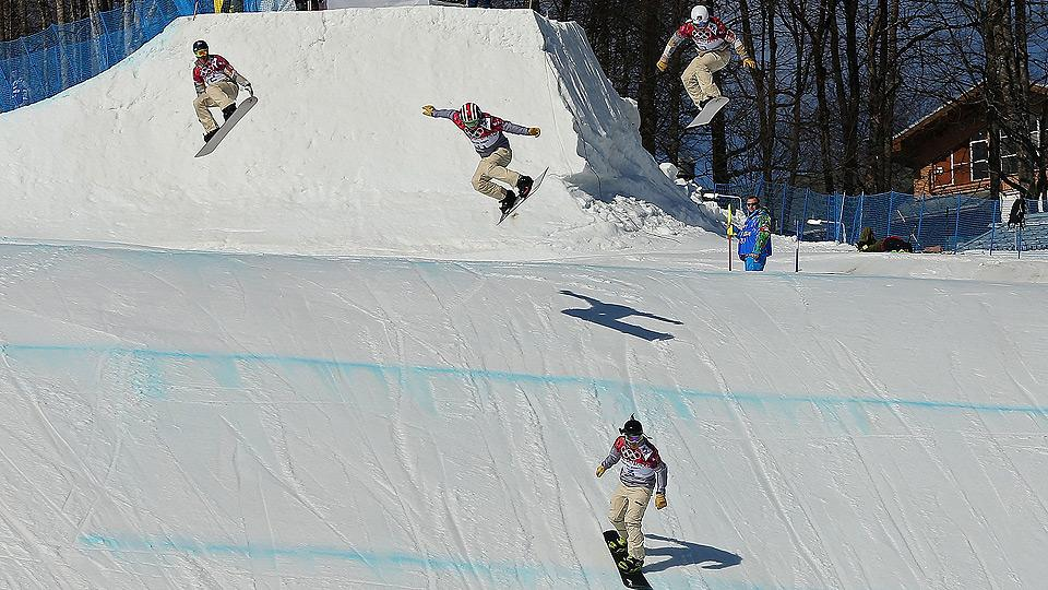 Snowboard cross riders must contend with obstacles, and each other, throughout a steep and twisty course.