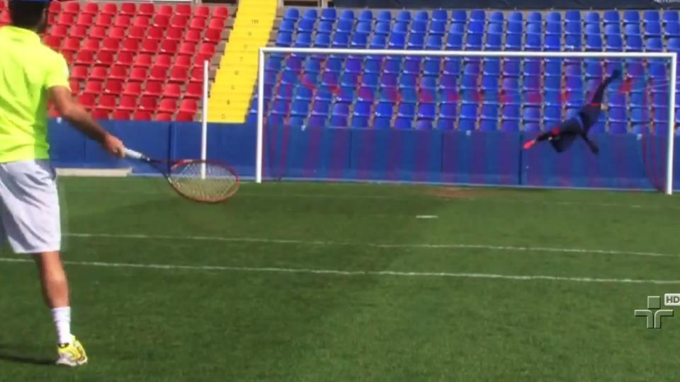 Watch Costa Rica's goalie block tennis balls hit at him by pro tennis player Pablo Andujay