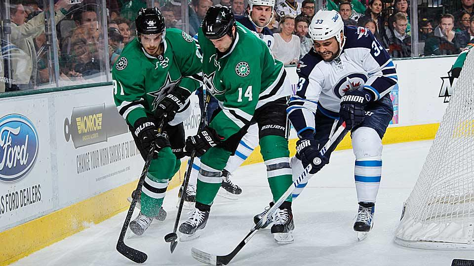 Thanks to a savvy GM, Tyler Seguin (81) and Jamie Benn (14) of the Stars have more to look forward to next season than do Dustin Byfuglien (33) and the Jets.