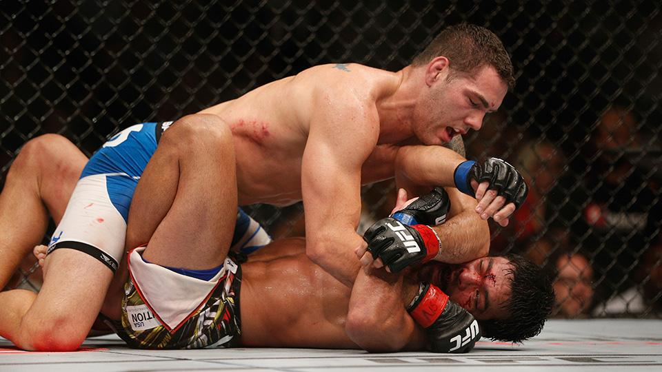 UFC middleweight champion Chris Weidman punches Lyoto Machida in their UFC middleweight championship fight at UFC 175 inside the Mandalay Bay Events Center on July 5, 2014 in Las Vegas, Nevada.